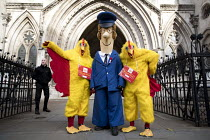 12-10-2017 - CWU protest against legal challenge by Royal Mail over a strike, Royal Courts of Justice, London. Postman Pat and chickens © Jess Hurd