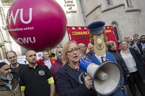 12-10-2017 - Gill Furniss MP and Postman Pat supporting CWU protest against legal challenge by Royal Mail over a strike, Royal Courts of Justice, London © Jess Hurd