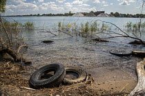 15-09-2017 - Windsor, Ontario, Canada, Old tires dumped at Peche Island, a wetland park in the Detroit River © Jim West