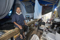 03-11-2017 - Rosharon, Texas, USA Cambodian immigrant farmers living in poor conditions more than two months afer Hurricane Harvey swept through southeast Texas. Im Vanthan, 76, is living in a makeshift tent after... © Jim West