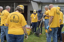 01-11-2017 - Houston, Texas USA Oklahoma volunteers from the Southern Baptist Convention pray with a resident after helping cleanup her home. The home was flooded when Hurricane Harvey dumped 50 inches of rain on... © Jim West