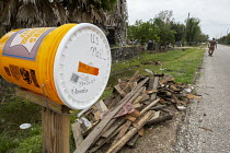 03-11-2017 - Rosharon, Texas, USA Temporary mailbox and debris from Hurricane Harvey in a community of Cambodian immigrants. Refugees fleeing the Khmer Rouge settled here in the early 1980s. The community is strug... © Jim West
