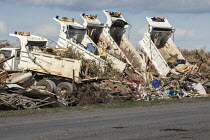15-11-2017 - Rockport, Texas USA Trucks dumping debris from the destruction wrought by Hurricane Harvey onto the median strip of state Highway 35 © Jim West