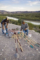 04-11-2017 - Big Bend National Park, Texas USA Mexicans with handicrafts for tourists to buy, overlooking the Rio Grande. American immigration authorities threaten to prosecute buyers because the items are brought... © Jim West