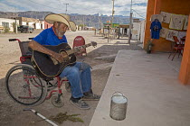 05-11-2017 - Boquillas del Carmen, Coahuila, Mexico A man in a wheelchair playing a guitar for tips from tourists. The small border town is popular with tourists who cross the Rio Grande from Big Bend National Par... © Jim West