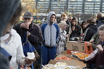 05-11-2017 - Homeless and hungry queuing for food, Coventry. The soup kitchen and food bank is provided by The Midland Langar Seva Society. Eating cake. © John Harris