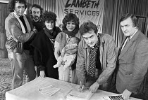 22-11-1983 - London 1983 Lambeth council celebrity petition in support of the campaign against rate capping and against cuts to services, with the leader of the council Ted Knight (R), Kika Markham with baby © NLA