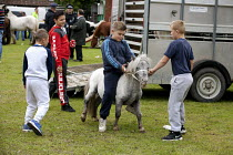 13-09-2015 - Horsmonden Gypsy Horse Fair, Kent. Horses on the village green, known as the Heath. For a few hours it becomes an important social event for the Gypsy and Traveller community. A group of boys and thei... © David Mansell