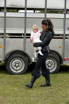 13-09-2015 - Horsmonden Gypsy Horse Fair, Kent. For a few hours it becomes an important social event for the Gypsy and Traveller community. A young Traveller mother carring her daughter. This Charter Fair dates ba... © David Mansell