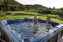 22-09-2016 - Enjoying an outdoor hot tub, Holday cottage, Cumbria © John Harris