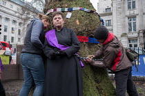 12-01-2018 - Vicar chained to tree in HS2 Euston protest. Rev Anne Stevens, Vicar of St Pancras, chained to one of more than 200 mature trees before felling begins to make way for HS2 construction trucks at Euston... © Philip Wolmuth