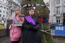 12-01-2018 - Vicar chained to tree in HS2 Euston protest. Local resident Jo Hurtfurd and Rev Anne Stevens, Vicar of St Pancras, chained to one of more than 200 mature trees before felling begins to make way for HS... © Philip Wolmuth