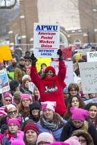 21-01-2018 - Lansing, Michigan USA Womens march protest against sexual harassment, violence against women and the presidency of Donald Trump. APWU member © Jim West