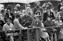 03-05-1975 - Stable lads strike for a living wage, Newmarket races 1975 Disgruntled racegoers watching pickets march round the racecourse © Martin Mayer
