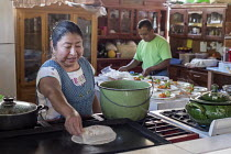24-02-2018 - Teotitlan del Valle, Oaxaca, Mexico, Mexican women working in her restaurant, Comedor Jaguar. Microfinance loans from the non profit En Via are supporting small businesses in the village © Jim West