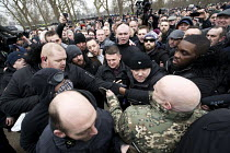 18-03-2018 - Security guards escorting Tommy Robinson from Speakers Corner. Football Lads Alliance and supporters of Tommy Robinson protest against far right speakers being refused entry to the UK, Hyde Park, Lond... © Jess Hurd