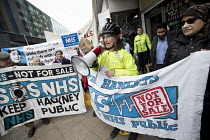 29-03-2018 - Dr Anna Livingstone GP, GPs and patients protest against GP at Hand, an online NHS service taking money away from local GP surgeries. Chrisp Street, Poplar, Tower Hamlets, East London © Jess Hurd