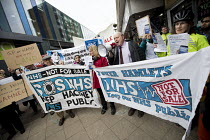 29-03-2018 - Dr Bennett Richards GP speaking, GPs and patients protest against GP at Hand, an online NHS service taking money away from local GP surgeries. Chrisp Street, Poplar, Tower Hamlets, East London © Jess Hurd