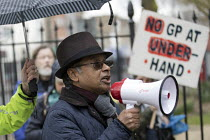 29-03-2018 - Dr Haroon Rashid, Whitechapel GP speaking, GPs and patients protest against GP at Hand, an online NHS service taking money away from local GP surgeries. Chrisp Street, Poplar, Tower Hamlets, East Lond... © Jess Hurd