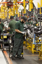 21-08-2017 - Jaguar Land Rover factory, Solihull. Workers assembling final drive © John Harris