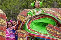 06-05-2018 - Detroit, Michigan, USA: Young Mexican dancers watching an older dancer performing during the Cinco de Mayo celebration © Jim West