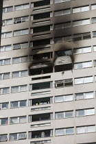 29-06-2018 - Firefighter looks out from a window of Grafton House where a twelfth floor fire is contained and brought under control by over 50 firefighters at a 22 story East End Homes tower block in Mile End, Eas... © Jess Hurd