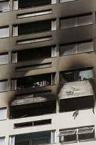 29-06-2018 - Woman takes down her washing. Grafton House where a twelfth floor fire is contained and brought under control by over 50 firefighters at a 22 story East End Homes tower block in Mile End, East London © Jess Hurd