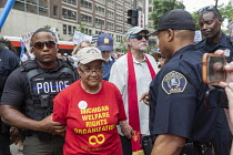 18-06-2018 - Detroit, Michigan USA Protest for the Poor Peoples Campaign against poverty, racism, militarism and ecological devastation. Member of the Michigan Welfare Rights Organization being arrested for blocki... © Jim West