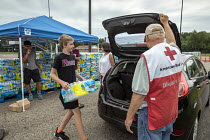 31-07-2018 - Parchment, Michigan USA, State of emergency declared after high levels of PFAS chemicals found in drinking water. Volunteers from the Red Cross and local High School distributing bottled water to resi... © Jim West