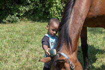 04-08-2018 - Detroit, Michigan,USA Detroit Horse Power, children riding and learning about horses at a city park, the organization is hoping to establish an urban horseback riding center on vacant land in the comm... © Jim West