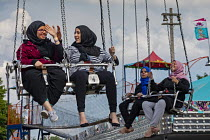 05-08-2018 - Dearborn, Michigan USA Young Arab-American women on the carnival ride, Annual Dearborn homecoming festival. Nearly half of Dearborn's residents are Arab-Americans, mostly Muslims © Jim West
