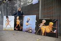 30-09-2018 - Artist Kaya Mar with satirical paintings of politicians Jacob Rees-Mogg, Boris Johnson, Theresa May and Donald Trump, Conservative Party Conference Birmingham 2018 © John Harris