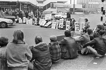 19-03-1979 - Speke, Liverpool, 1979 Dunlop workers sit down protest blocking roads against factory closure with 2,400 job losses © NLA