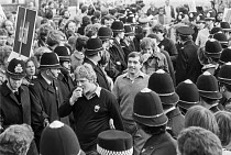 17-10-1979 - Coventry 1979 Anti Apartheid protest Barbarians Rugby team. South African players protected by police pass through Anti Apartheid protest against the Rugby football Tour, Coundon Road Stadium. Stop Ra... © Peter Arkell