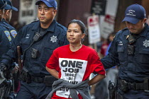 12-10-2018 - San Francisco, USA Hotel workers striking against low pay sit-in outside Marriott Marquis Hotel and are arrested by Police. The low wages force many workers to work an additional job. © David Bacon