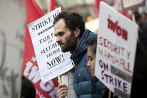 10-30-2018 - Security marshall on strike, Rise of precarious workers protest, supporting Uber drivers for employment rights in the High Court, organised by IWGB trade union, London © Jess Hurd