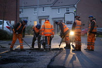23-11-2018 - Workers laying tarmac road on a housing estate, Rugeley, Staffordshire © John Harris
