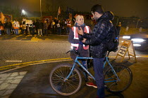 23-11-2018 - Amazon workers protest against working conditions, Black Friday, Rugeley, Staffordshire. GMB organiser talking to a migrant worker © John Harris