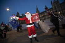 12-12-2018 - Santa Claus Pro EU Protest outside Parliament on the evening of Teresa May confidence vote, Westminster, London © Jess Hurd