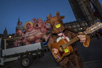 12-12-2018 - Rudolph the reindeer with Brexit is a Monstrosity sculpture by Jacques Tilly outside Parliament on the evening of Teresa May confidence vote, Westminster, London. The float has a multi-headed chimera... © Jess Hurd
