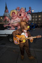12-12-2018 - Man dressed as Rudolph the reindeer with Brexit is a Monstrosity sculpture by Jacques Tilly outside Parliament on the evening of Teresa May confidence vote, Westminster, London. The float has a multi-... © Jess Hurd