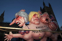 12-12-2018 - Brexit is a Monstrosity sculpture by Jacques Tilly outside Parliament on the evening of Teresa May confidence vote, Westminster, London. The float has a multi-headed chimera with the faces of Theresa... © Jess Hurd