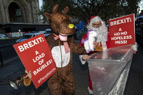 12-12-2018 - Rudolph the reindeer, Santa Claus Pro EU Protesters outside Parliament on the evening of Teresa May confidence vote, Westminster, London © Jess Hurd