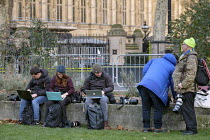 12-12-2018 - News photographers using laptops to file photos from the media area, College Green, Westminster, London, on the day Conservative MPs launched a leadership challenge © Philip Wolmuth