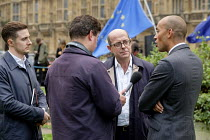 15-11-2018 - Chuka Umunna MP interviewed by BBC Radio journalist Nick Robinson, College Green, Westminster, London, on the day of four ministerial resignations over Brexit deal. © Philip Wolmuth