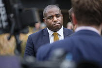 15-11-2018 - David Lammy MP interviewed by TV journalist, College Green, Westminster, London, on the day of four ministerial resignations over Brexit deal. © Philip Wolmuth