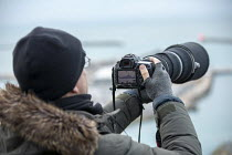 01-01-2019 - Press photographing the boarder patrol boat Searcher, looking for refugees crossing the Channel Channel from France, New Years Day, Port of Dover, Kent. © Jess Hurd