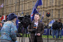 15-01-2019 - Press TV news presenter, College Green as Parliament prepares to vote on Brexit, Westminster, London © Philip Wolmuth