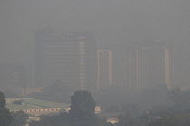 06-11-2018 - Air pollution in India, Delhi. High rise buildings through morning smog. Air pollution in India is a serious issue with the major sources being fuelwood and biomass burning, fuel adulteration, vehicle... © Martin Mayer