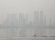 11-11-2018 - Air pollution in India, Mumbai; High rise buildings through morning smog. Mumbai as the fourth most polluted city in the world. Air pollution in India is a serious issue with the major sources being f... © Martin Mayer